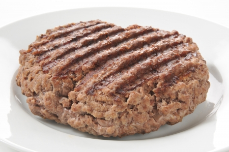 A thick juicy grilled ground beef patty Stok Fotoğraf