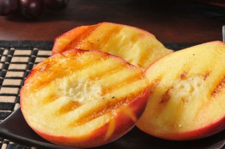 pitted: A plate of fresh grlled peaches, a summertime treat