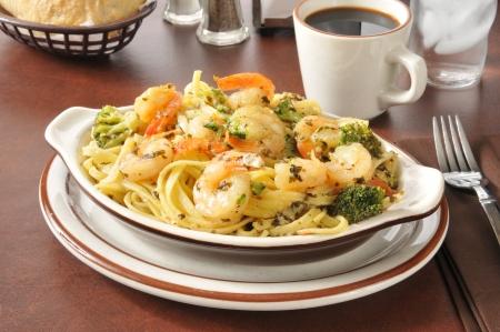A bowl of shrimp scampi on linguine