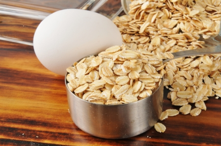 egg cups: A measuring cup of oatmeal and a fresh egg