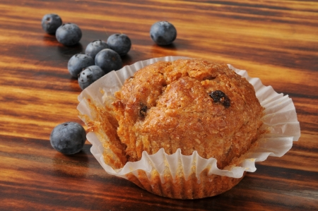A blueberry bran muffin on a cutting board Stock Photo