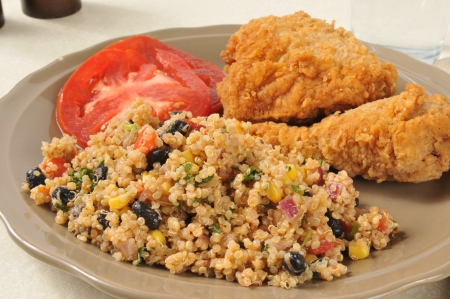 Healthy black bean and quinoa salad with fried chicken