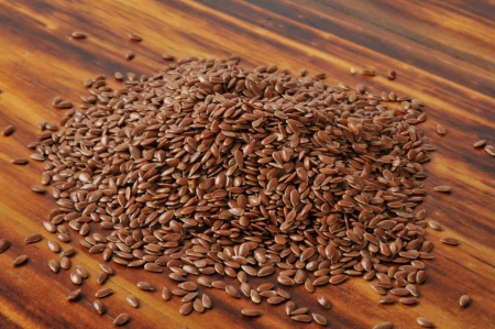 A mound of flax seed on a cutting board photo