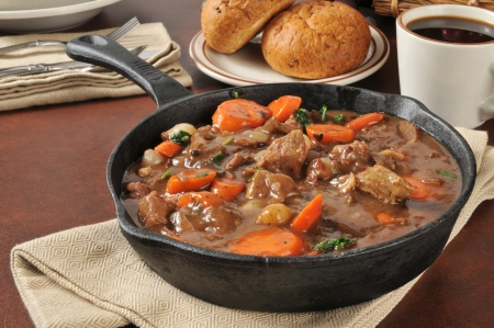 stew pan: Gourmet beef stew bourguignon with carrots, pearl onions and burgundy wine sauce
