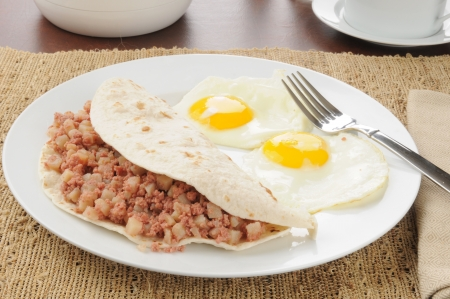 hash: A corned beef hash breakfast burrito with fried eggs
