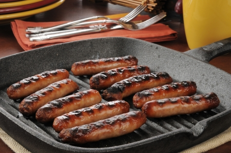 cast iron pan: Grilled link sausage in a cast iron pan