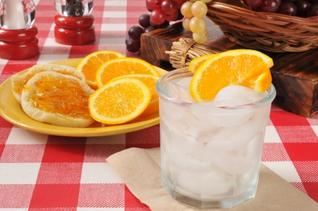 seltzer: An orange spritzer, with English muffins topped with orange marmalade