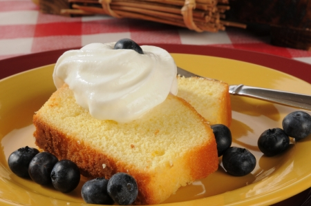 pound cake: Fresh blueberries and whipped cream on delicious pound cake Stock Photo