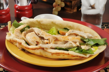 Open faced chicken Caesar sandwich on flatbread photo