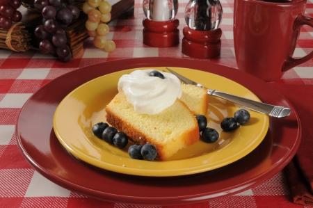 shortcake: Fresh blueberries on pound cake slices with whipped cream Stock Photo