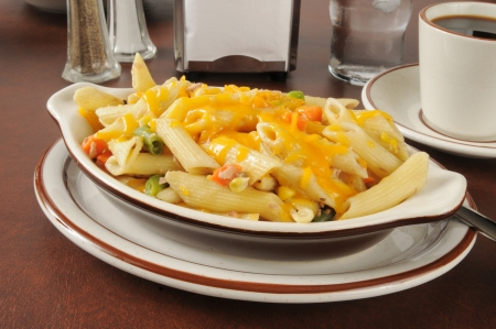 tunafish: Tuna casserole with mixed vegetables topped with cheddar cheese