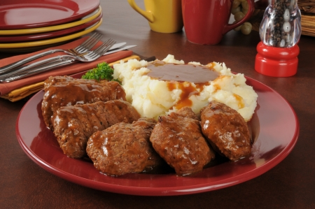 A platter of meatloaf with mashed potatoes and gravy served family style Stock Photo - 21638000