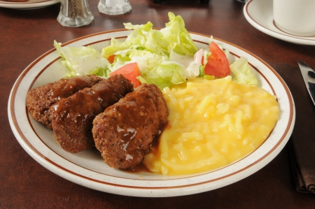 meatloaf: Juicy meatloaf with salad and julienne potatoes au gratin Stock Photo