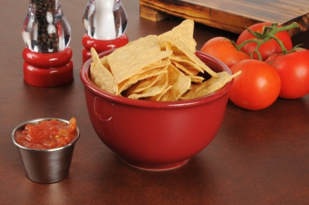 Tortilla chips with salsa and fresh tomatoes photo