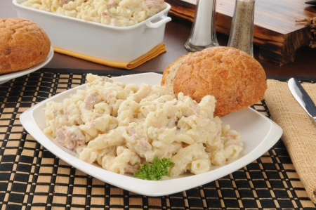 Tuna noodle casserole with a dinner roll