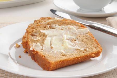 buttered: Close up of buttered banana nut bread Stock Photo