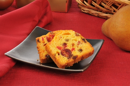 Traditional Christmas fruit cake near a pear photo