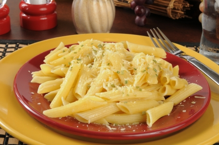 A plate of buttered penne rigate noodles topped with pamesan and romano cheeses Banco de Imagens - 21987849