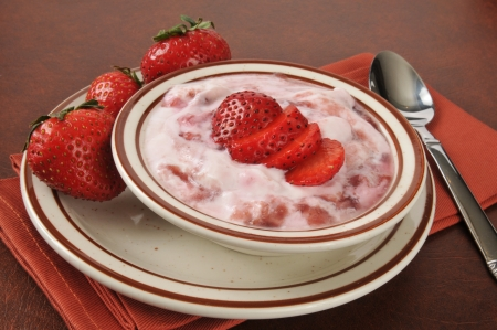 Healthy Greek yogurt with fresh strawberry topping