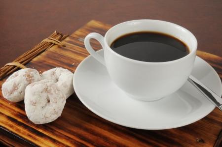 Coffee with mini powdered sugar donuts Stock Photo