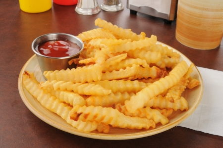 catsup: A plate of french fries and catsup