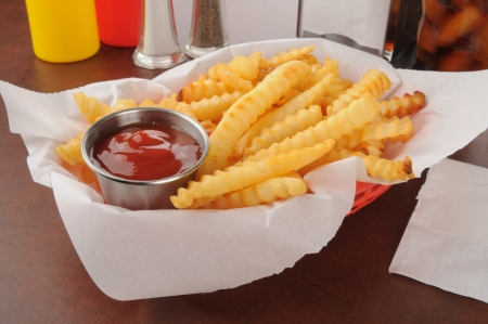 catsup: A basket of french fries with catsup Stock Photo