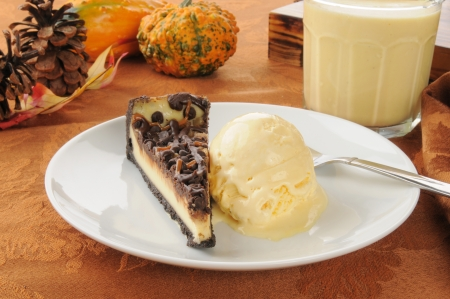 egg nog: A slice of turtle cheesecake with ice cream and egg nog Stock Photo