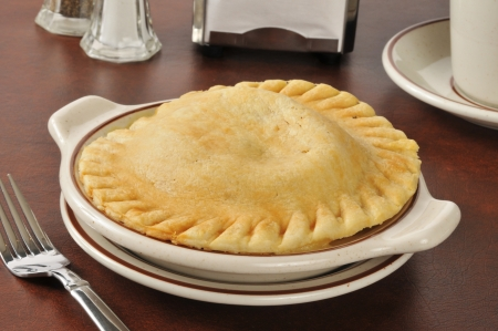 A fresh baked chicken pot pie served in a country diner photo