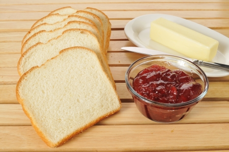sliced bread with jam and butter