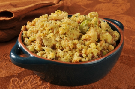 A bowl of cornbread stuffing with celery and turkey chunks