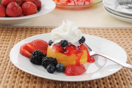 shortcake: Dessert shortcake with strawberries, blueberries, blackberries and whipped cream