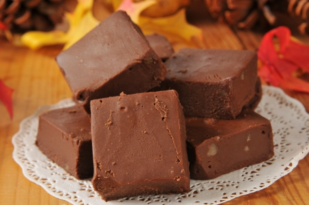 Nut fudge squares on a wooden table with holiday decorations