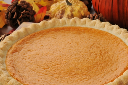 Closeup of pumpkin or sweet potato pie on a holiday table photo