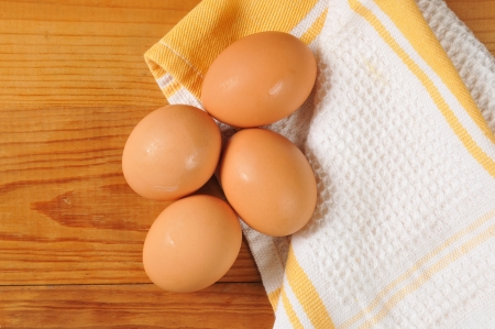 Fresh brown eggs on a kitchen towel