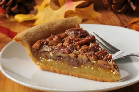 A slice of pecan pie on a colorful holiday table Stock Photo