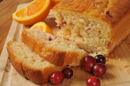Sliced cranberry orange bread with fresh fruit photo
