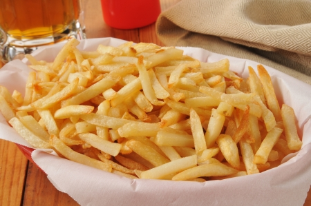 A basket of french fries and a mug of beer Stok Fotoğraf