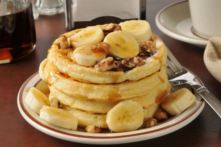 A stack of banana nut waffles with syrup in a diner photo