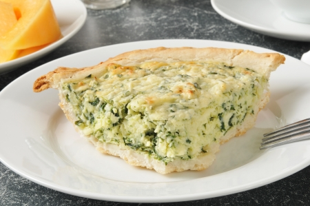 florentine: Quiche Florentine with sliced cantaloupe