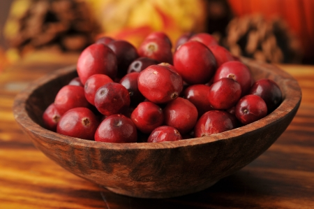 cutting bord: A wooden bowl of fresh organic cranberries Stock Photo