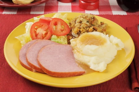 stuffing: Sliced ham with stuffing and salad