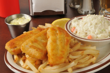 Beer battered fish sticks with french fries and coleslaw