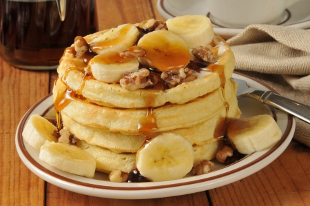 A stack of banana nut waffles with maple syrup