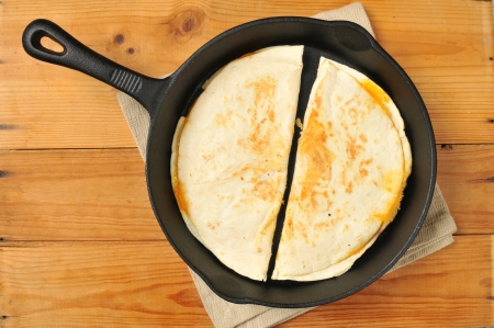 skillet: Cheese quesadillas in a cast iron skillet Stock Photo