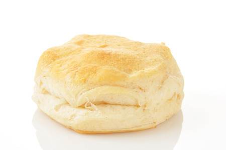 flaky: A large buttermilk biscuit on a white background Stock Photo