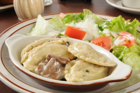 Chicken and portabello mushroom ravioli with a garden salad photo