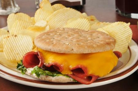 A fried baloney sandwich on thin round sandwich bread Stock Photo
