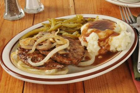 steak dinner: Salisbury steak smoothered in gravy with sauteed onions and mushrooms Stock Photo
