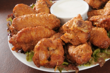 Closeup of chicken wings with ranch dip