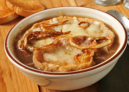 A bowl of French Onion soup with gruyere cheese photo